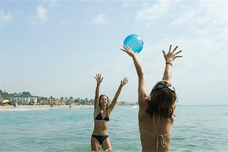 Teen girls playing with beach ball in sea Stock Photo - Premium Royalty-Free, Code: 632-02745226