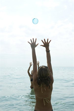 Teen girls playing with beach ball in sea Stock Photo - Premium Royalty-Free, Code: 632-02745249