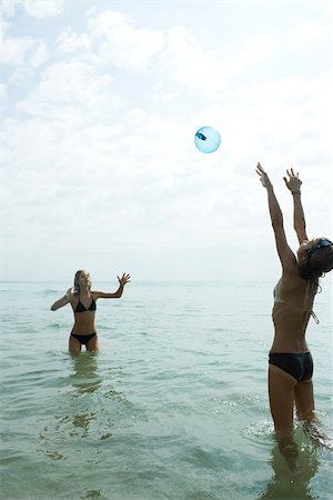 Teen friends waist deep in water playing with beach ball Stock Photo - Premium Royalty-Free, Code: 632-02745243