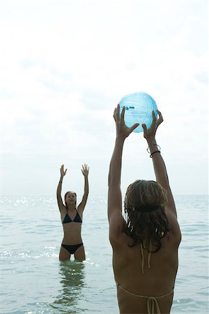 Teen girls playing with beach ball in sea Stock Photo - Premium Royalty-Free, Code: 632-02745251
