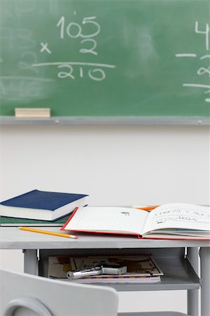 school desk - Handgun hidden in school desk Stock Photo - Premium Royalty-Free, Code: 632-02745326
