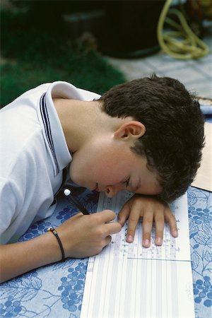Young boy correcting music homework Stock Photo - Premium Royalty-Free, Code: 632-03027079