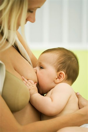 Woman breast feeding baby Stock Photo - Premium Royalty-Free, Code: 632-03027227