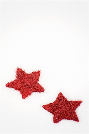 stars on white background - Red stars placed on snow Stock Photo - Premium Royalty-Free, Code: 632-03027591