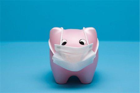 prevention - Swine flu concept, toy pig wearing flu mask Stock Photo - Premium Royalty-Free, Code: 632-03083393