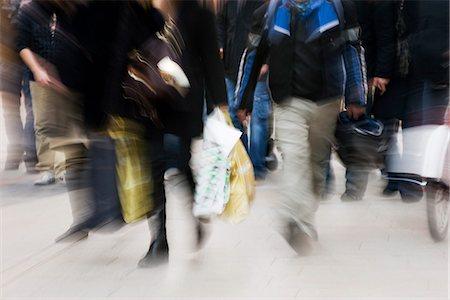 forward - Pedestrians walking on sidewalk, blurred Stock Photo - Premium Royalty-Free, Code: 632-03083493