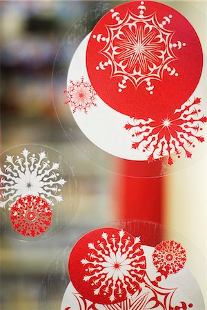 snowflakes  holiday - Window decorated with Christmas decals, close-up Stock Photo - Premium Royalty-Free, Code: 632-03083507