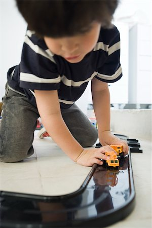 Little boy playing with cars on plastic track Stock Photo - Premium Royalty-Free, Code: 632-03083589