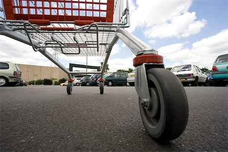 empty shopping cart - Shopping cart in parking lot, surface level view Stock Photo - Premium Royalty-Free, Code: 632-03193726