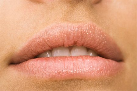 Young woman's mouth, close-up Stock Photo - Premium Royalty-Free, Code: 632-03403324