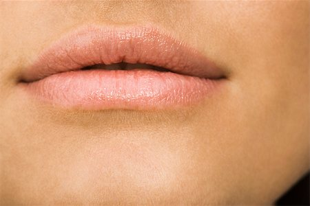 Young woman's mouth, close-up Stock Photo - Premium Royalty-Free, Code: 632-03403325
