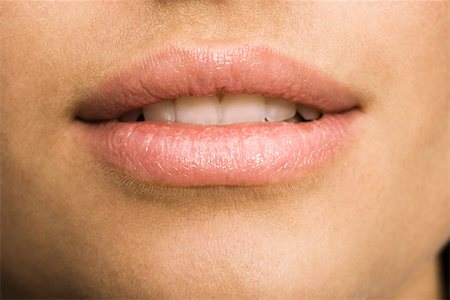 Young woman's mouth, close-up Stock Photo - Premium Royalty-Free, Code: 632-03403323