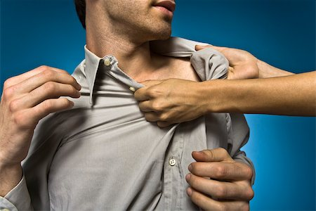 Woman grabbing man by shirt collar Stock Photo - Premium Royalty-Free, Code: 632-03403407