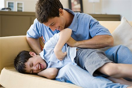Father tickling young son Stock Photo - Premium Royalty-Free, Code: 632-03424351