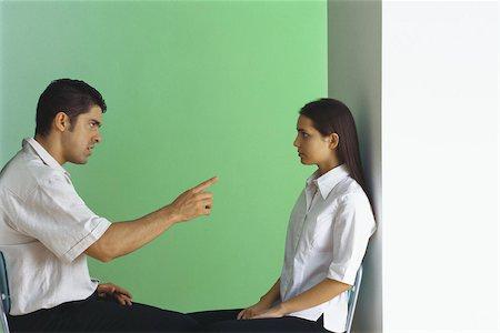 Man reprimanding teenage girl Stock Photo - Premium Royalty-Free, Code: 632-03424693