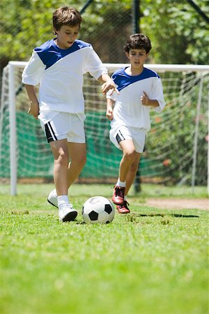 football team - Children playing soccer, cropped Stock Photo - Premium Royalty-Free, Code: 632-03500666