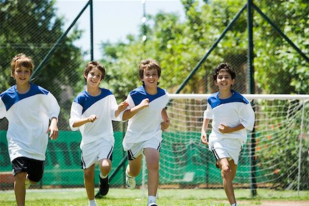 football team - Boys running on soccer field Stock Photo - Premium Royalty-Free, Code: 632-03500668
