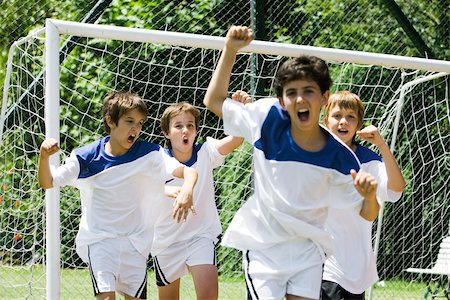 football team - Boys playing soccer Stock Photo - Premium Royalty-Free, Code: 632-03500671