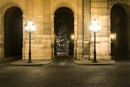 Arcade illuminated by street lamps, The Louvre, Paris, France Stock Photo - Premium Royalty-Free, Code: 632-03500718