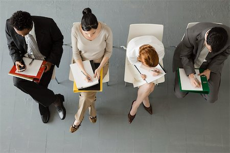Professionals taking notes during meeting Stock Photo - Premium Royalty-Free, Code: 632-03500807