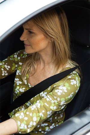 Woman driving car wearing seatbelt Stock Photo - Premium Royalty-Free, Code: 632-03500914