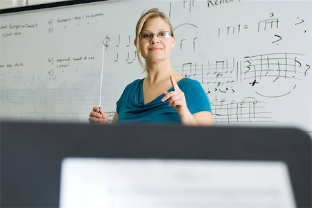 Music teacher conducting Stock Photo - Premium Royalty-Free, Code: 632-03501100
