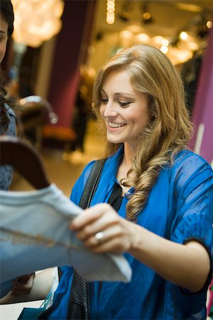 Friends shopping in clothing boutique Stock Photo - Premium Royalty-Free, Code: 632-03516669