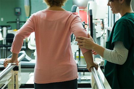 rehabilitation - Patient undergoing rehabilitation walking exercises with assistance from physical therapist Stock Photo - Premium Royalty-Free, Code: 632-03516717