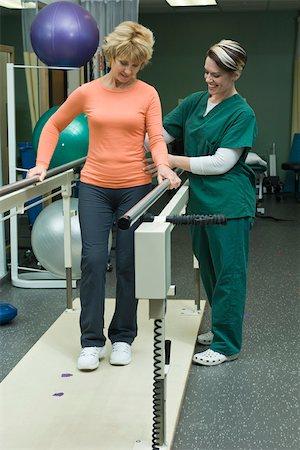 rehabilitation - Woman undergoing post-surgery rehabilitation exercises to regain ability to walk Stock Photo - Premium Royalty-Free, Code: 632-03516727