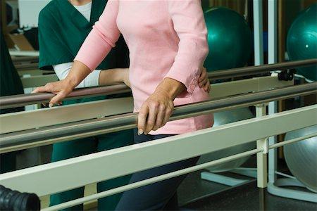 rehabilitation - Patient undergoing post-surgery rehabilitation exercises to regain ability to walk Stock Photo - Premium Royalty-Free, Code: 632-03516761