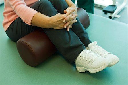 rehabilitation - Using exercise cushion for leg stretch exercise Stock Photo - Premium Royalty-Free, Code: 632-03516784