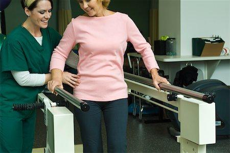 rehabilitation - Woman undergoing post-surgery rehabilitation exercises to regain ability to walk Stock Photo - Premium Royalty-Free, Code: 632-03516801