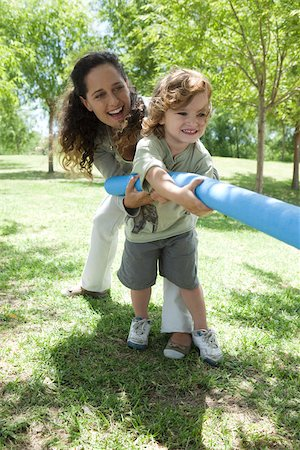Mother and young son playing tug-of-war Stock Photo - Premium Royalty-Free, Code: 632-03516990