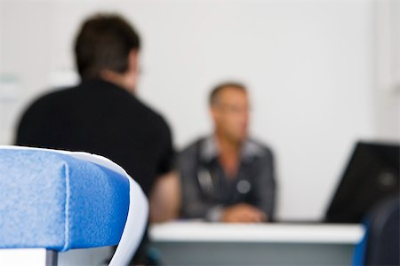 Doctor consulting patient in clinic Stock Photo - Premium Royalty-Free, Code: 632-03629637