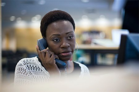 Female office worker talking on phone Stock Photo - Premium Royalty-Free, Code: 632-03629854