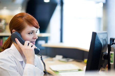 switchboard operator - Female receptionist talking on phone Stock Photo - Premium Royalty-Free, Code: 632-03629870