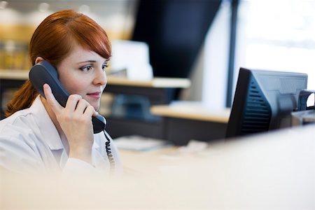 switchboard operator - Female receptionist talking on phone Stock Photo - Premium Royalty-Free, Code: 632-03629871