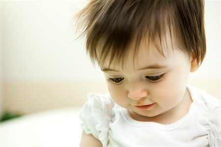 shy baby - Baby girl looking down, portrait Stock Photo - Premium Royalty-Free, Code: 632-03630064