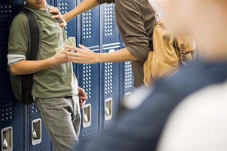 Teenage boy bullying classmate and stealing his money Stock Photo - Premium Royalty-Free, Code: 632-03630168