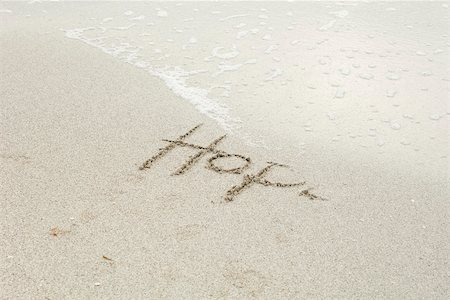 "The word ""hope"" written in the sand at the beach, partially washed away by the tide Stock Photo - Premium Royalty-Free, Code: 632-03630261"