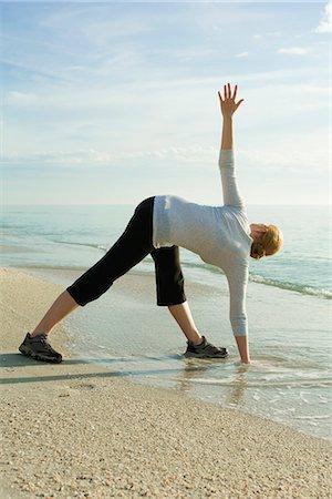 Woman doing yoga at the beach Stock Photo - Premium Royalty-Free, Code: 632-03651840