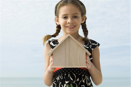 Girl holding birdhouse, portrait Stock Photo - Premium Royalty-Free, Code: 632-03652310