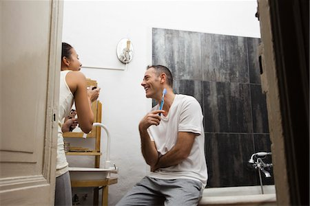 Couple together in bathroom getting ready in morning Stock Photo - Premium Royalty-Free, Code: 632-03754286