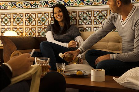 Friends hanging out together in living room Stock Photo - Premium Royalty-Free, Code: 632-03754291