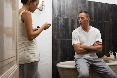 Couple talking in bathroom Stock Photo - Premium Royalty-Free, Code: 632-03754316