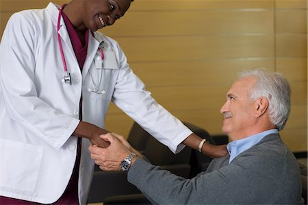 doctor in waiting room - Doctor reassuring patient in waiting room Stock Photo - Premium Royalty-Free, Code: 632-03754424