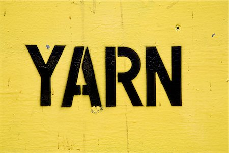 """stenciling - Stenciled lettering on sign reading """"yarn"""" Stock Photo - Premium Royalty-Free, Code: 632-03754538"""