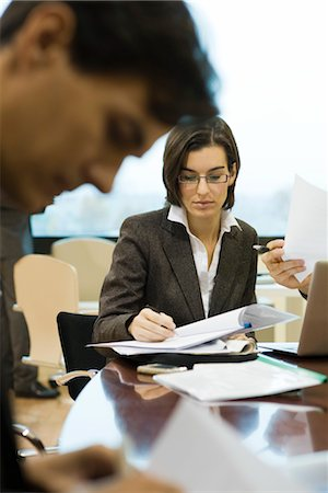 Executives reviewing documents in meeting Stock Photo - Premium Royalty-Free, Code: 632-03754709