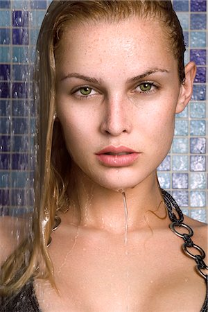 Young woman in shower, portrait Stock Photo - Premium Royalty-Free, Code: 632-03779269