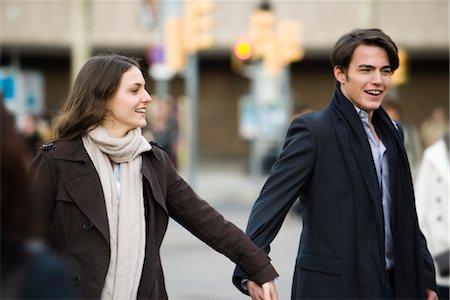 Couple walking hand in hand Stock Photo - Premium Royalty-Free, Code: 632-03779656